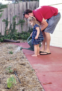 Josh gardening at home with his daughter. Photo courtesy Josh Ayers.